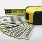 hundred-dollar bills and a tape measure